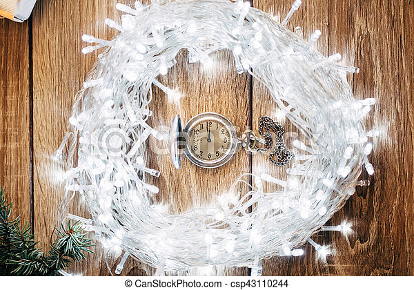 Vintage Clock on Fir Tree Garland Showing Five Minutes to Midnight - Christmas Concept