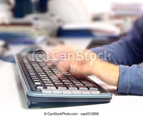 Woman writing quickly on a computer keyboard - csp4312656