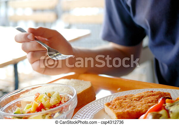 man eating healthy food it an restaurant - csp4312736