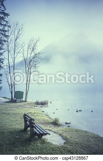 Bench on Lake Shore and Fog - csp43128867