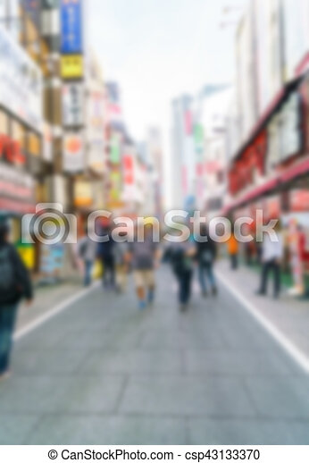 Abstract blur Crowd of anonymous people walking on busy street