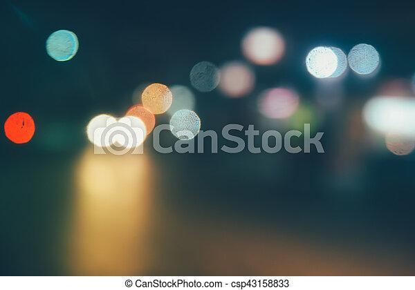 Defocused lights car traffic jam of a street road at night retro color effect