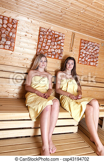 Beautiful young girlfriends get together to use relaxation in the spa. A relaxing sauna bath.