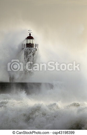 Old lighthouse of the Portuguese north coast after being violently hit by a powerful wave at sunset
