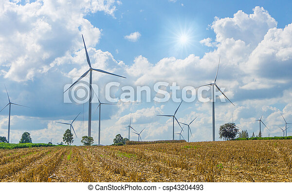 Many wind turbine in meadow. The electric power is a clean energy and help save the planet from global warming.