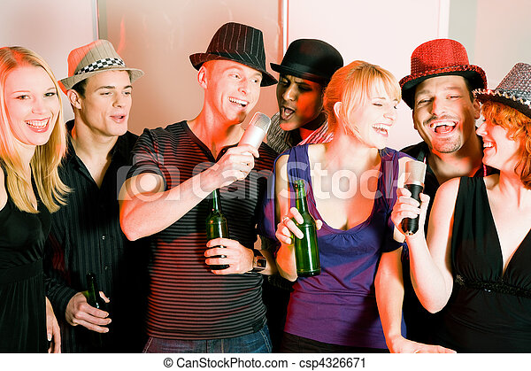 Group of friends at karaoke party - csp4326671