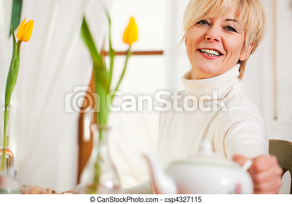 Woman grabbing coffee or tea pot - csp4327115