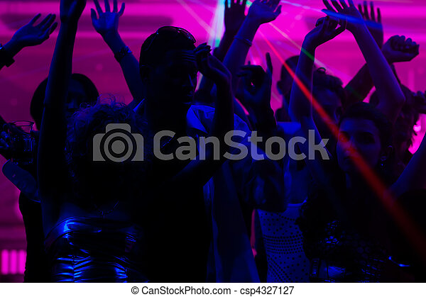 People dancing in club with laser - csp4327127