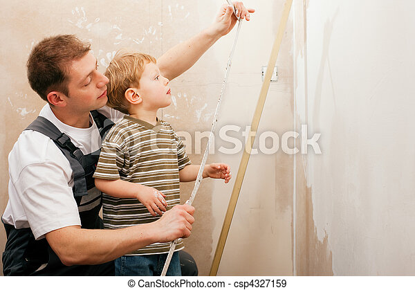Father and son measuring dry wall - csp4327159