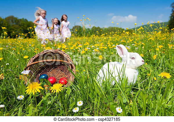 Children on Easter egg hunt with bunny - csp4327185