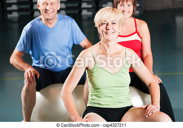 People in gym on exercise ball - csp4327211