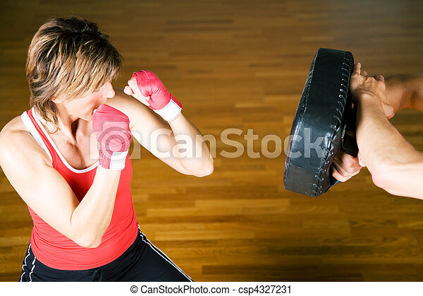 Sparring session in martial arts moves, couple exercising