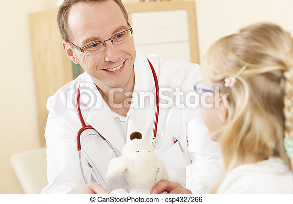 Child giving a soft toy to doctor - csp4327266