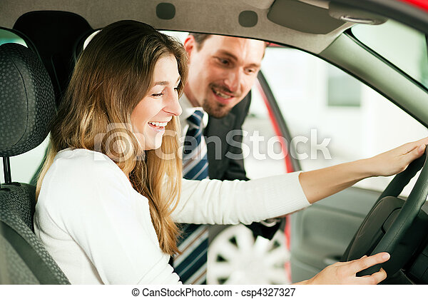 Woman buying car from salesperson - csp4327327