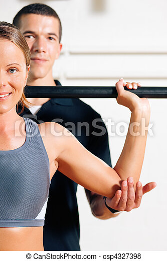 Personal Trainer in gym - csp4327398