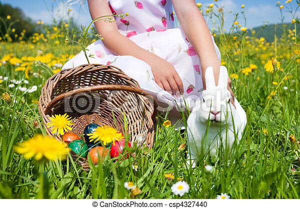 Little girl petting the Easter bunny - csp4327440