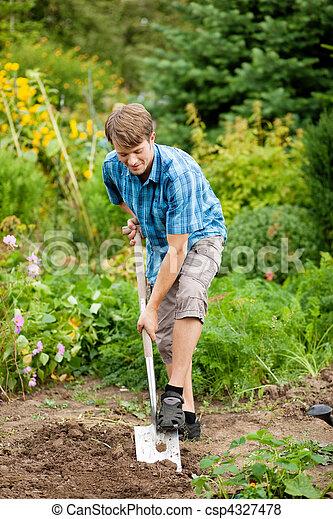 Gardening - man digging over the soil - csp4327478