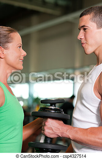 Dumbbell training in gym - csp4327514