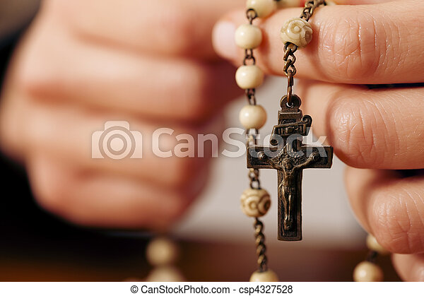 Woman praying with rosary to God - csp4327528