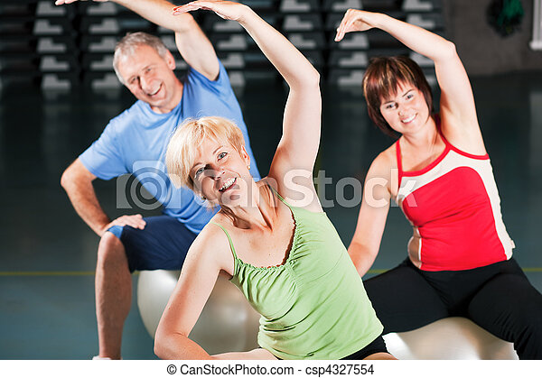 People in gym on exercise ball - csp4327554