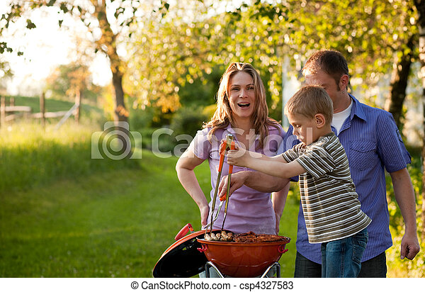 Family having BBQ in their garden - csp4327583