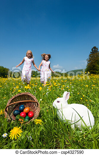 Children on Easter egg hunt with bunny - csp4327590