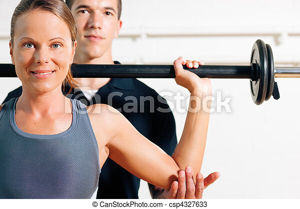 Personal Trainer in gym - csp4327633