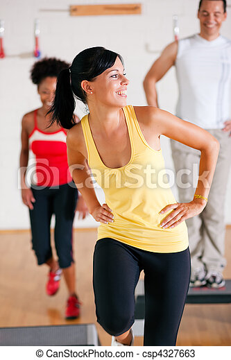 Step Training in gym with instructor - csp4327663