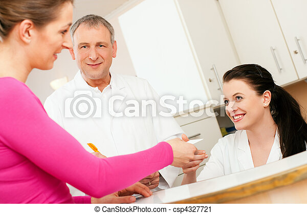 Woman at reception of clinic - csp4327721