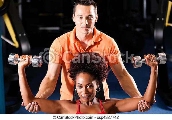 Personal Trainer in gym - csp4327742
