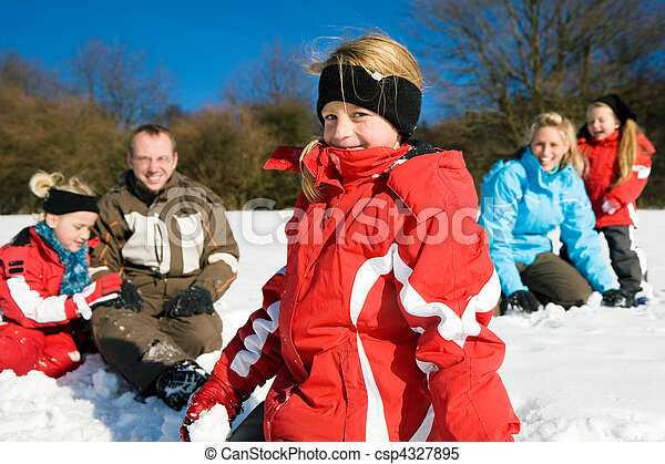 Family having a snowball fight - csp4327895