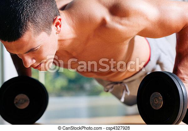 Man exercising  in gym - push ups - csp4327928