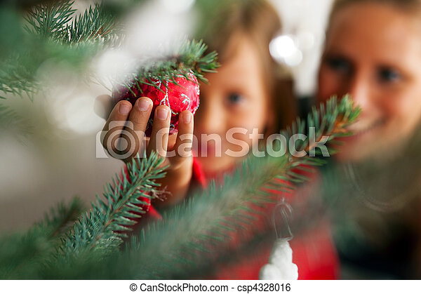 Family decorating Christmas tree - csp4328016