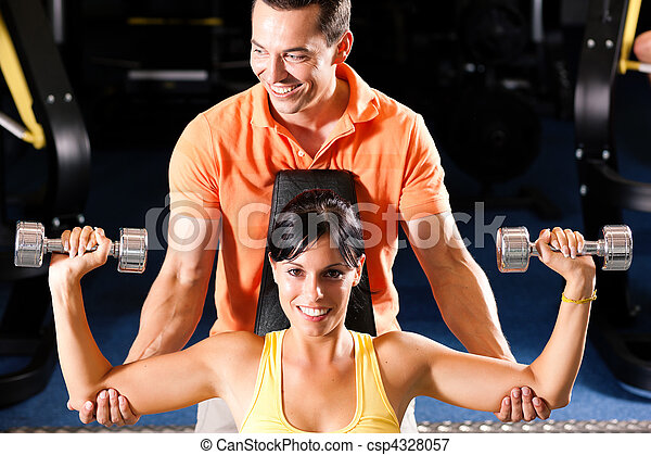 Personal Trainer in gym - csp4328057