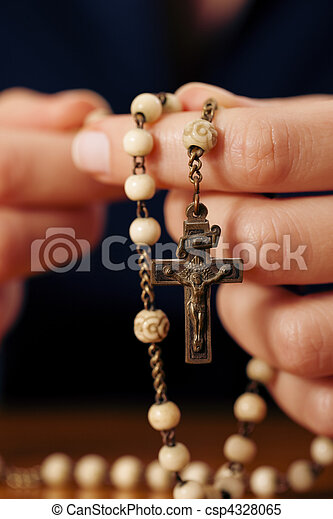 Woman praying with rosary to God - csp4328065