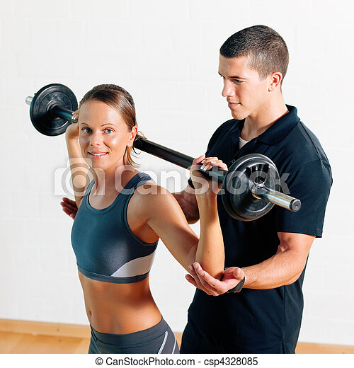 Personal Trainer in gym - csp4328085