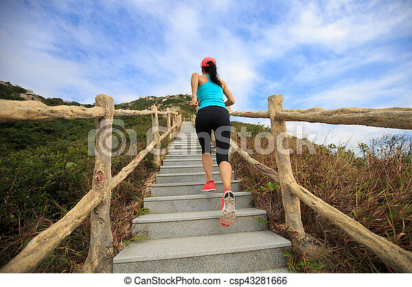young fitness woman running on mountain stairs - csp43281666