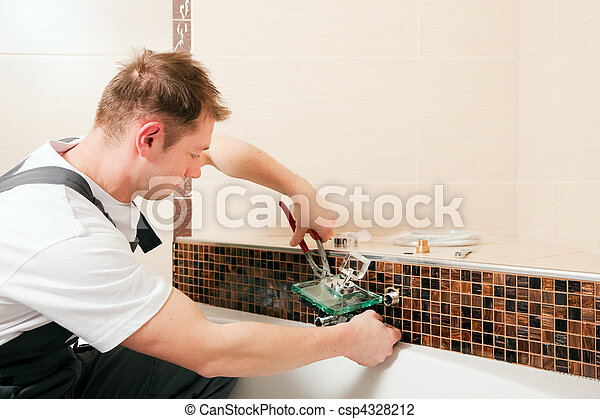 Plumber installing a mixer tap in a bathroom - csp4328212