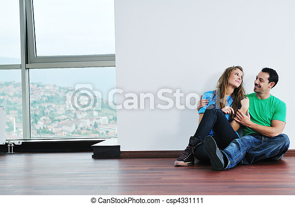 happy couple in empty apartment - csp4331111