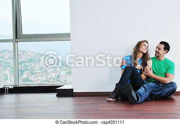 happy couple in empty apartment - csp4331111
