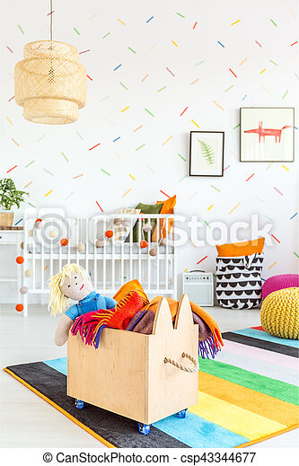 White child room with wooden toy box
