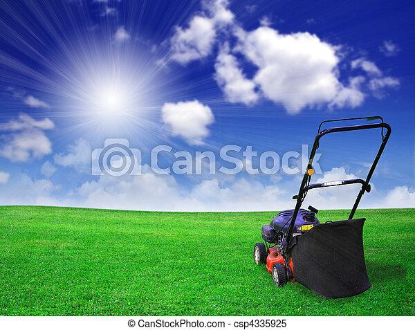 Lawn mower on green field - csp4335925