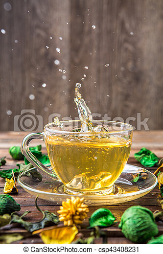 Decorated with dried flowers table with mug of green tea