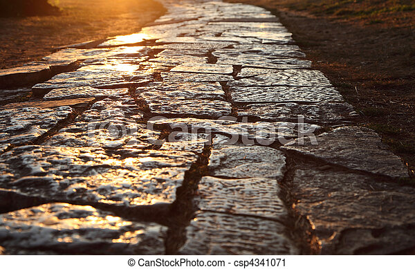 Ancient cobblestone pavement in the old town of Pula, Croatia - csp4341071