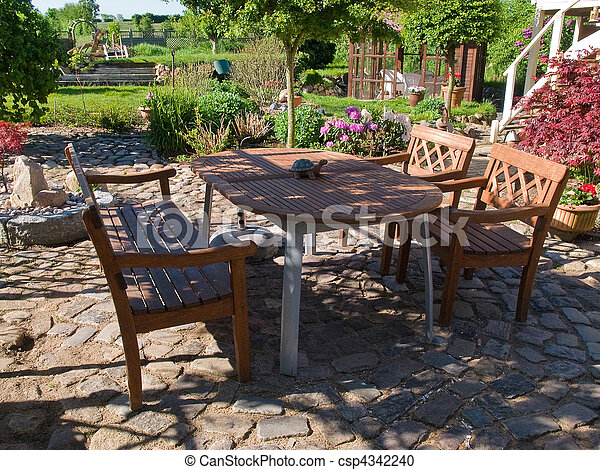 Formal garden furniture in a patio - csp4342240
