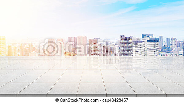 Business concept - Empty concrete floor top with panoramic modern cityscape building bird eye aerial view under sunrise and morning blue bright sky of Tokyo, Japan for display or montage product