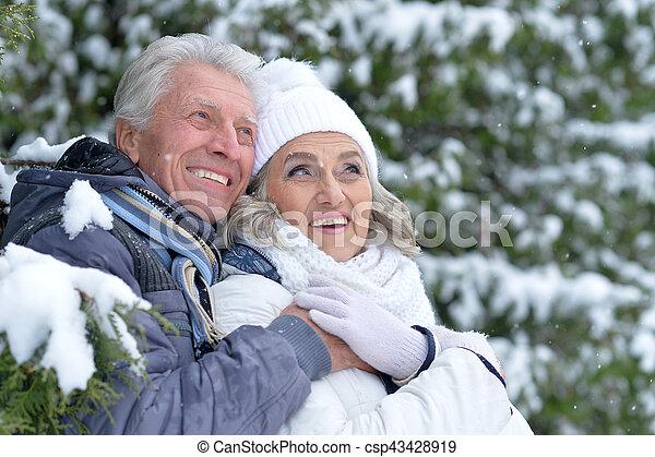 happy mature couple posing outdoor in winter