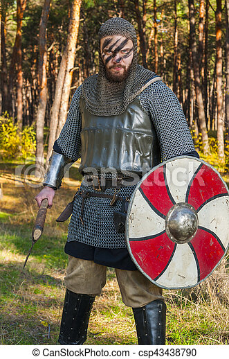 Stock Photographs of Viking holding sword and shield over wild ...