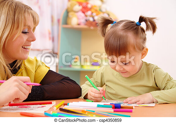 Teacher with child in preschool - csp4350859