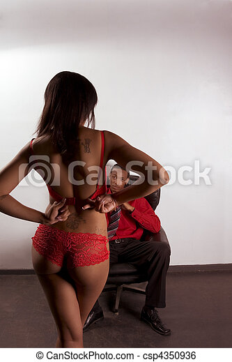 Striper woman in red dancing for young black man - csp4350936